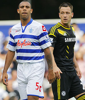 John Terry (right) was fined and suspended for racially abusing Anton Ferdinand (left).