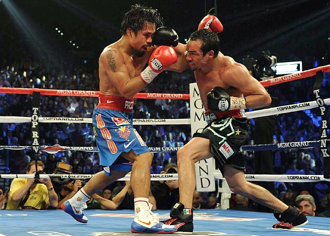 Manny Pacquiao may well fight again, but after being knocked out cold by Juan Manuel Marquez in a ferocious fourth fight, the Filipino fighter has lost his aura. Chris Mannix discusses what comes next for the world's most famous boxer.