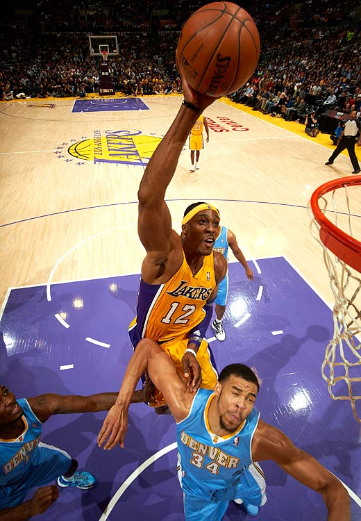 Still only 27, Dwight Howard is on his way to being recognized as one of the NBA's all-time best centers. Howard averages well over a double-double per game: 18.4 points and 13.0 rebounds. After Howard left Orlando for Los Angeles in the offseason, it's uncertain whether the Magic will retire his number. Orlando still hasn't retired Shaquille O'Neal's jersey because of the way he left town.