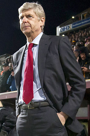 Arsene Wenger and Arsenal are in seventh place in the Premier League.
