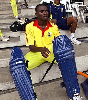A member of the Lagos state cricket team prepares for a match with Kaduna state.