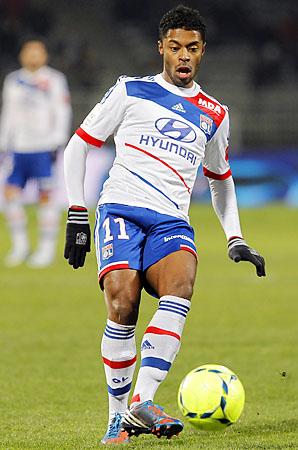 Michel Bastos and Lyon lead Ligue 1 over Paris Saint-Germain.
