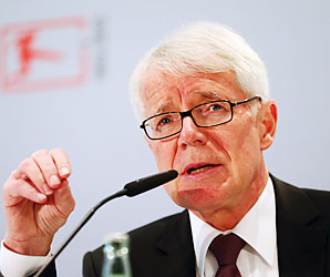 Reinhard Rauball, president of the German Football League, talks at a news conference announcing new security measures.
