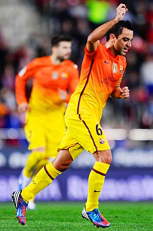 Xavi and first-place Barcelona face second-place Atletico Madrid this weekend.