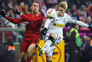 Franck Ribery (left) of Bayern Munich is challenged by Oscar Wendt in their Bundesliga match Friday.
