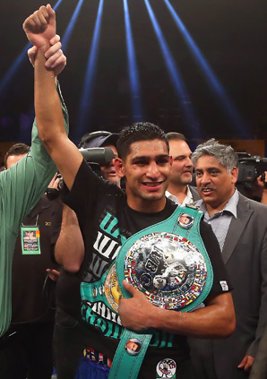 Amir Khan dominated Carlos Molina, whose corner asked the referee to stop the fight after 10 rounds.