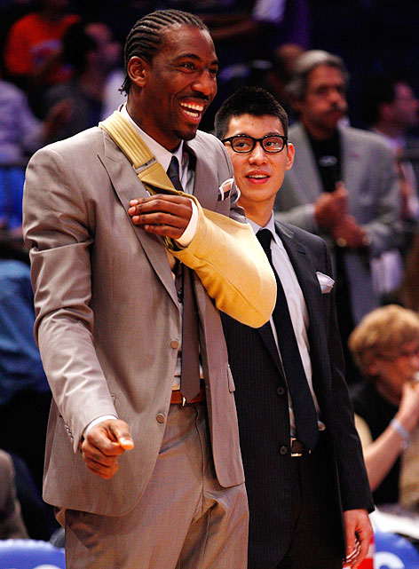 The Knicks shut down Lin in late March with a knee injury that would eventually sideline him for the postseason as well. Here, he watches the playoffs from the sidelines with an injured Amar'e Stoudemire.