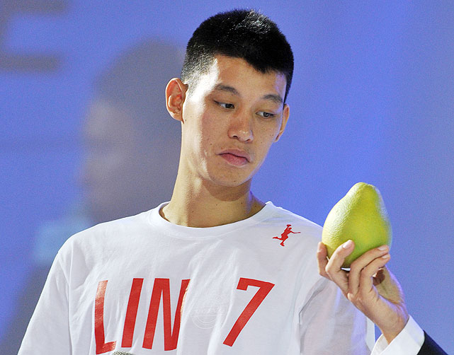 Lin studies a grapefruit in the summer of 2012.
