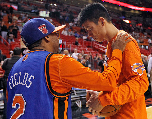 Lin shares a moment with Knicks superfan Spike Lee. Lee donned Lin's No. 4 Palo Alto High School jersey during the Knicks' game against the Hornets on Feb. 17.