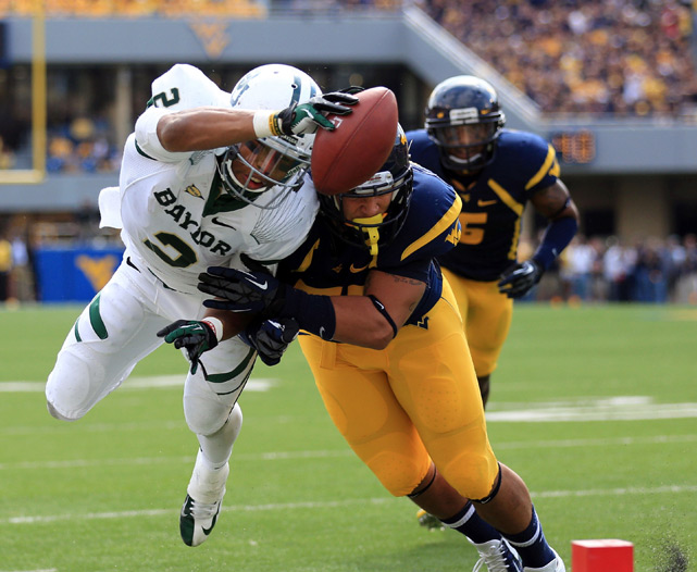 Baylor and West Virginia combined for 70 points and 711 yards of total offense -- and that was all in just he first half. At the end of the day, the score resembled a college basketball score -- the Mountaineers won, 70-63 -- more than a college football one.