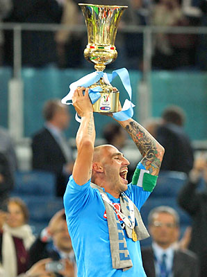 Paolo Cannavaro lifts the Italian Cup for Napoli in May.