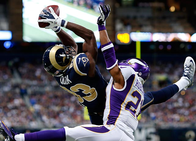 St. Louis' Brian Quick snags a pass from quarterback Sam Bradford for a four-yard touchdown over Minnesota's Josh Robinson. However the Vikings went on to win, 36-22.