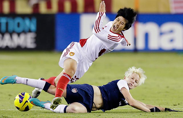 Ren Guixin of China and Megan Rapinoe of the U.S. go after the ball in an exhibition match. The U.S. won 4-1.