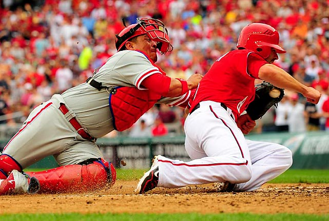 Philadelphia Phillies catcher Carlos Ruiz puts the tag on Washington Nationals second baseman Danny Espinoza.