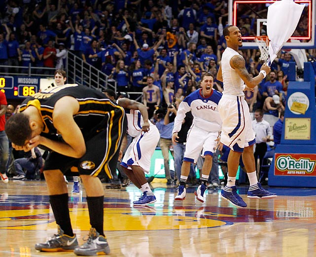 Kansas celebrates while Missouri guard Michael Dixon holds his head in despair after the Jayhawks won this regular season rivalry classic 87-86 in overtime.