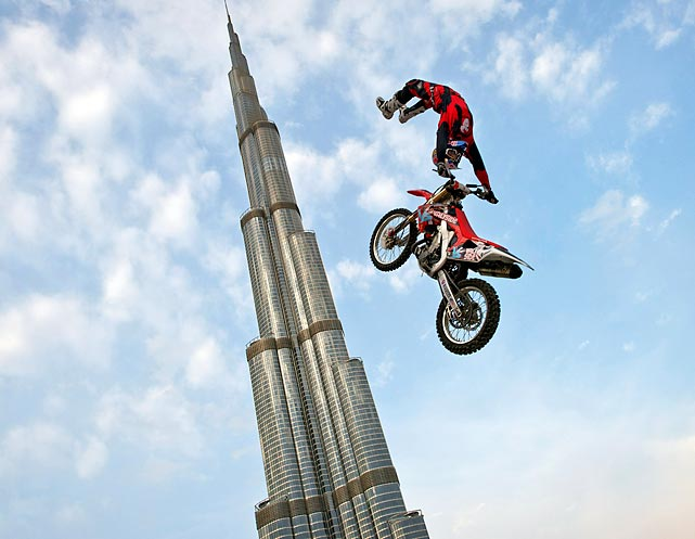 Motorcross biker performs a show jump in front of the world's tallest building, Burj al-Khalifa in Dubai.
