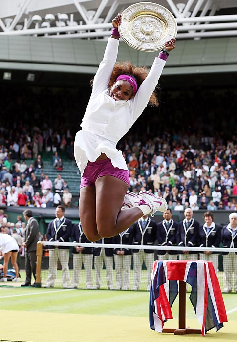 Serena Williams lifts the famous silver Venus Rosewater Dish after overcoming Agnieszka Radwanska 6-1, 5-7, 6-2 to win Wimbledon for the fifth time.