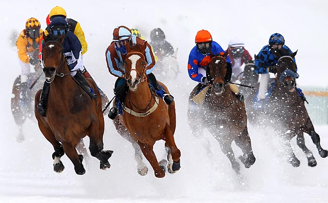 Horses and their riders compete in the Grand Prix Prestige race in St. Mroitz, Switzerland, in February.