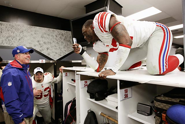 The Giants were in a celebratory mood after they defeated the 49ers in the NFC Championship Game. Defensive back Derrick Martin decided to climb on top of the lockers and videotape coach Tom Coughlin.