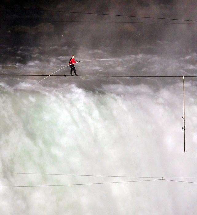 Tightrope walker Nik Wallenda walks across the border between the United States and Canada as he traverses Niagara Falls on a wire. Wallenda set a world record for being the first person to ever walk over Niagara Falls.