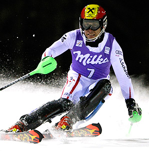 Austria's Marcel Hirscher easily claims the World Cup night slalom event in Italy.