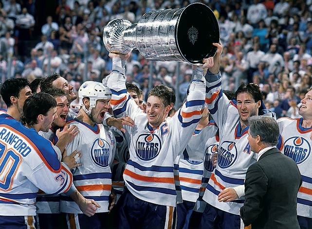 The Great One's electrifying rewriting of NHL scoring records and stature as hockey's biggest superstar overshadowed his quiet leadership. In his first season as the Oilers' captain, he led them to their first Stanley Cup, dethroning the Islanders' dynasty in the process. (He later said he'd learned how to win by seeing how much the Isles gave in sweeping his Oilers for the Cup the prior year.) Three more Cups followed during the next four years. After his 1988 trade to L.A., the nine-time NHL MVP donned the C, which he later shared with Luc Robitaille due to back problems while leading the Kings to the 1993 Cup final.