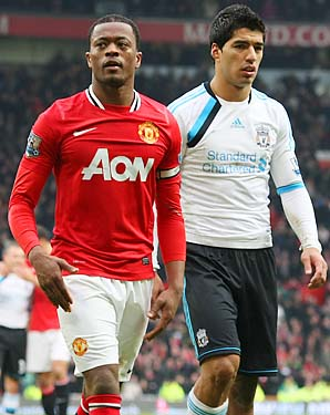 Luis Suarez (right) was banned eight matches for racially abusing Patrice Evra (left).