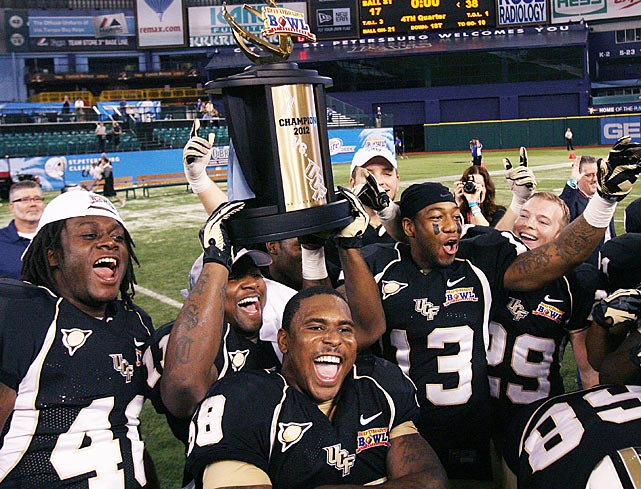 While you were sleeping, SI.com pulled together these shots from the wide-ranging night in sports, beginning with the University of Central Florida celebrating after it defeated Ball State 38-17 in the Beef O'Brady's Bowl at Tropicana Field in St. Petersburg, Fla.