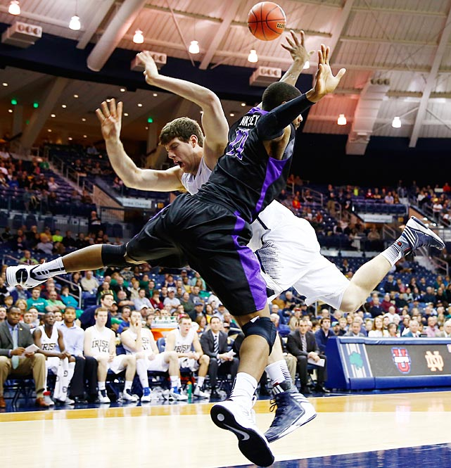 Tom Knight of Notre Dame and Ameen Tanksley of the Niagara Purple Eagles collided under the basket at Purcel Pavilion in South Bend.