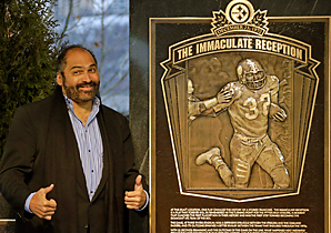 "Pittsburgh Steelers' Franco Harris stands on the spot of the ""Immaculate Reception"" after a marker commemorating the 40th anniversary of the play was unveiled."