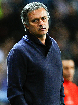 Jose Mourinho looks on during his team's 3-2 loss to Malaga.