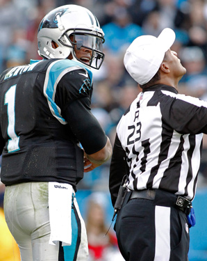 Cam Newton shouted at and bumped referee Jerome Boger in the fourth quarter of the Panthers' 17-6 win over the  Raiders.