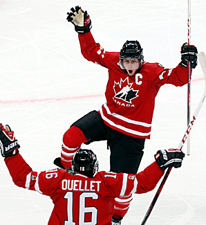 Ryan Nugent-Hopkins celebrates his first-period goal against the United States with teammate Xavier Ouellet.