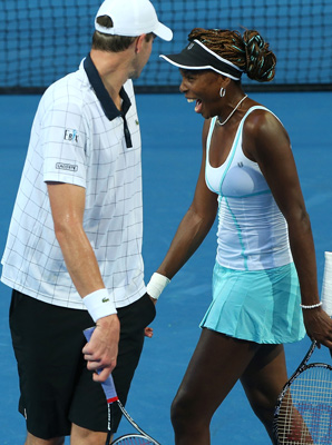 John Isner and Venus Williams share a laugh during Sunday's match.