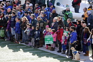 A contingent of teachers, parents and students from Sandy Hook Elementary School in Newtown, Conn., take part in pregame ceremonies.
