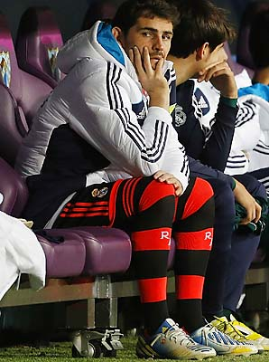 Iker Casillas sits on the bench during Real Madrid's match with Malaga on Dec. 22.