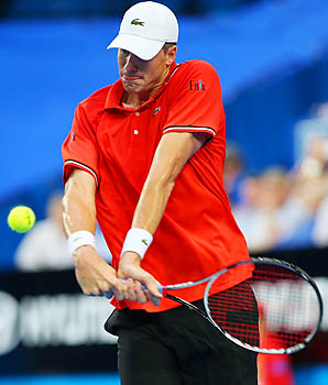John Isner still hopes to compete as the top-ranked American at the Australian Open beginning Jan. 14.