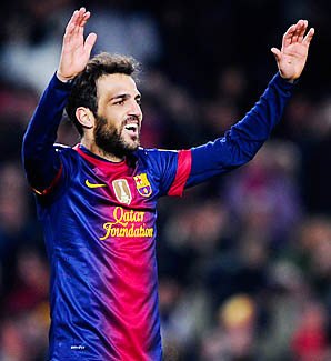 Cesc Fabregas and Barcelona lead La Liga and are into the final 16 of the Champions League.