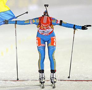 Vita Semerenko crosses the finish line to win the women's biathlon relay for Ukraine.