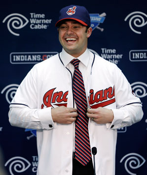 Nick Swisher signed a four-year, $56 million contract with Cleveland.