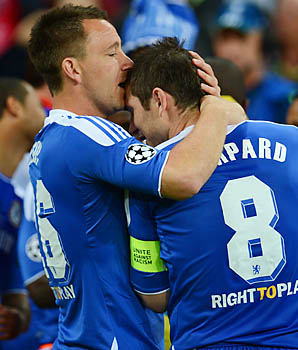 John Terry and Frank Lampard embrace after winning the Champions League in May.