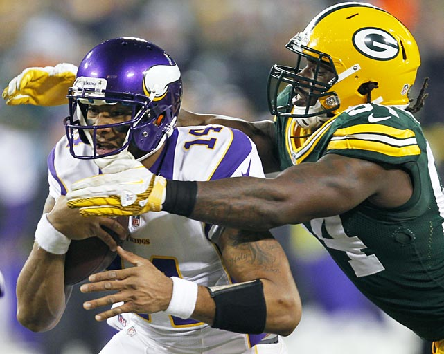 Green Bay linebacker Dezman Moses closes in on Minnesota backup quarterback Joe Webb, who was forced to start in place of an injured Christian Ponder.