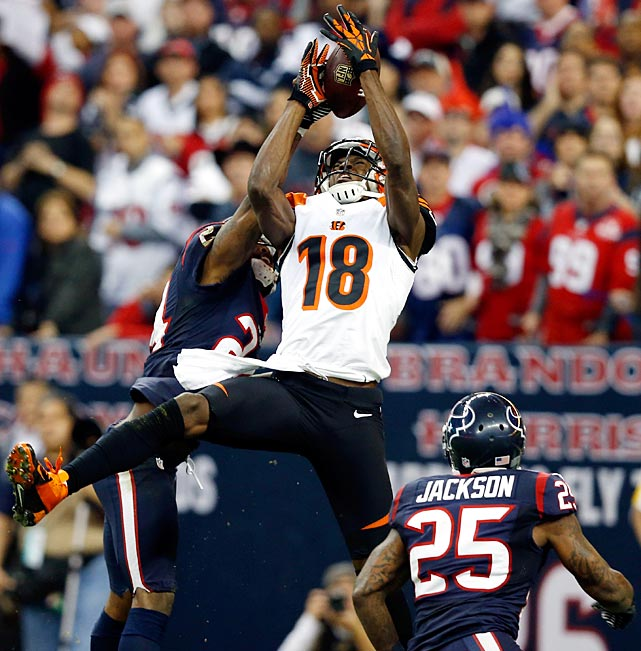 Texans cornerback Jonathan Joseph (background) keeps A.J. Green from making a toucdown reception.