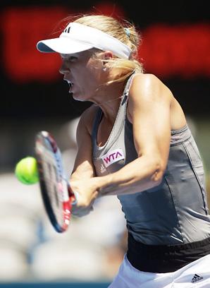 Caroline Wozniacki dominated Poland's Urszula Radwanska to open the Sydney International.
