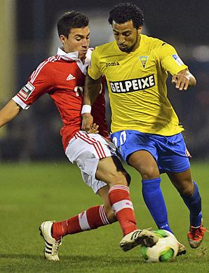Nicolas Gaitan (left) scored to help Benfica.