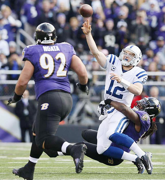 Dannell Ellerbe brings down Andrew Luck on a day in which the rookie was held without a touchdown pass.