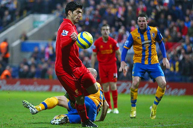 Luis Suarez appears to control the ball with his hand against Mansfield Town.