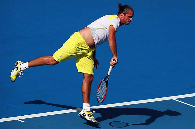 Xavier Malisse serves during his first-round match against Martin Kilzan.