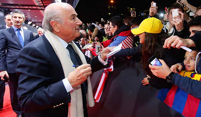 Sepp Blatter signs autographs for fans during the red carpet arrivals at the FIFA Ballon d'Or Gala.