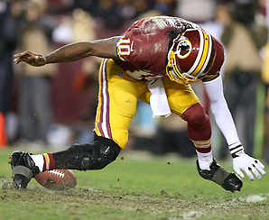 In the fourth quarter, Robert Griffin III's knee buckled the wrong way when he tried to field a bad shotgun snap.